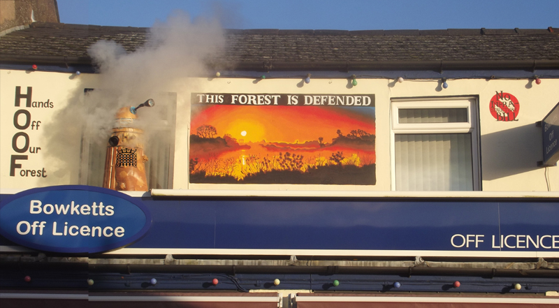 This forest is defended mural by Tom Cousins for Hands Off Our Forest